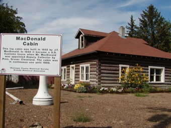 The Old Log Cabins is part of the Oroville, WA Depot Museum